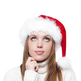 Thoughtful woman in a Santa hat isolated on white background Royalty Free Stock Photos