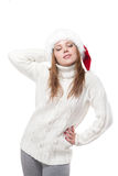 Thoughtful woman in a Santa hat isolated on white background Royalty Free Stock Photo