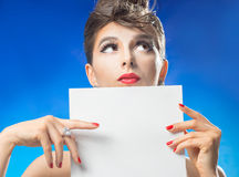 Thoughtful woman with a sheet paper Royalty Free Stock Photography