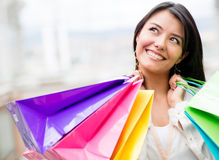 Thoughtful woman shopping Royalty Free Stock Images