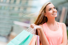 Thoughtful woman shopping Stock Photo