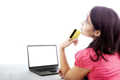 Thoughtful woman shopping online Stock Photos