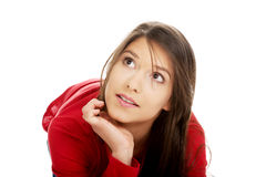 Thoughtful woman sitting on the floor. Royalty Free Stock Photography