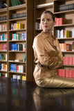 Thoughtful Woman Sitting On Library Desk Stock Image