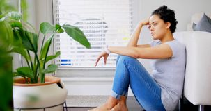 Thoughtful woman sitting near sofa in living room 4k. Thoughtful woman sitting near sofa in living room at home4k stock video