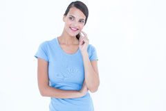 Thoughtful woman smiling with finger on cheek Royalty Free Stock Photos