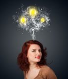 Thoughtful woman with smoke and lightbulbs above her head Royalty Free Stock Photography