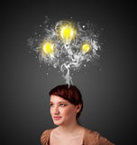 Thoughtful woman with smoke and lightbulbs above her head Stock Photography