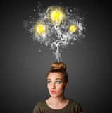Thoughtful woman with smoke and lightbulbs above her head Royalty Free Stock Photos
