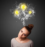 Thoughtful woman with smoke and lightbulbs above her head Stock Images