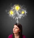Thoughtful woman with smoke and lightbulbs above her head Royalty Free Stock Images
