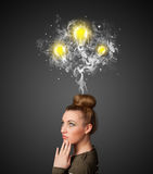 Thoughtful woman with smoke and lightbulbs above her head Royalty Free Stock Image