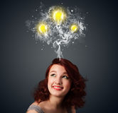 Thoughtful woman with smoke and lightbulbs above her head Royalty Free Stock Photo