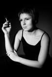 Thoughtful woman smoking Stock Photos