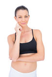 Thoughtful woman in sportswear looking at camera Stock Photography