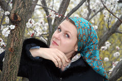 Thoughtful woman in the spring garden Royalty Free Stock Image