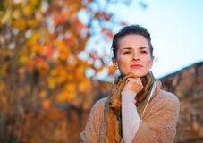 Thoughtful woman standing in autumn outdoors Royalty Free Stock Image