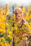 Thoughtful woman standing in autumn vineyard Royalty Free Stock Photo