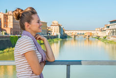 Thoughtful woman standing on bridge in florence Royalty Free Stock Photo