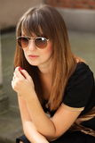 Thoughtful woman on street of old town Royalty Free Stock Images