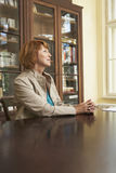 Thoughtful Woman At Study Table In Home Royalty Free Stock Photos