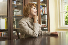 Thoughtful Woman At Study Table In Home Stock Photos