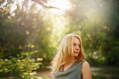 Thoughtful Woman in Summer Sunny Day. Outdoor Portrait. Space for Your Text. Selective Focus Royalty Free Stock Image