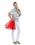 Thoughtful woman in sweater with shopping bags Royalty Free Stock Images