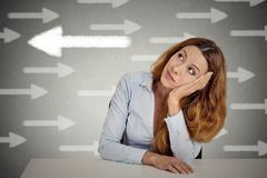 Thoughtful woman taking a chance going against flow Royalty Free Stock Images