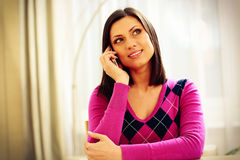 Thoughtful Woman Talking On The Phone Stock Images
