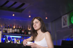 Thoughtful Woman With Teacup At Bar Stock Image