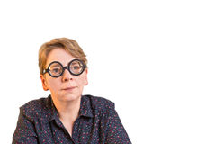 Thoughtful woman with thick glasses Royalty Free Stock Photos