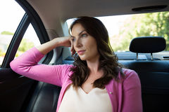 Thoughtful woman traveling in car Royalty Free Stock Photo