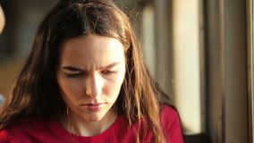 Thoughtful woman traveling by train stock footage