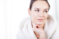 Thoughtful woman after treatments in spa Royalty Free Stock Photo