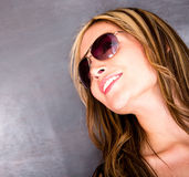 Thoughtful woman wearing sunglasses Royalty Free Stock Photos