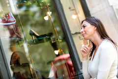Thoughtful woman window shopping Stock Images