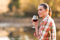 Thoughtful woman wine Stock Image