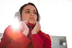 Thoughtful women wearing coat and ear muffs Royalty Free Stock Photo