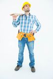 Thoughtful worker carrying wooden planks Royalty Free Stock Photos