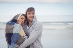 Thoughtful youn couple embracing during winter Royalty Free Stock Images