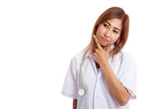 Thoughtful, Young Asian female doctor Stock Image