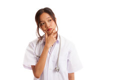 Thoughtful, Young Asian female doctor Royalty Free Stock Image