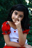 Thoughtful young Asian girl Royalty Free Stock Image