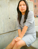 Thoughtful Young Asian Girl Sit Outdoor royalty free stock photo