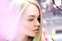 Thoughtful young blonde with blue eyes looking away Stock Photography