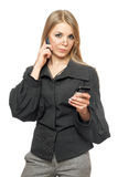 Thoughtful young blonde in a gray business suit Stock Image