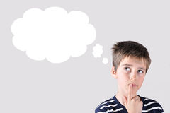 Thoughtful young boy Royalty Free Stock Images