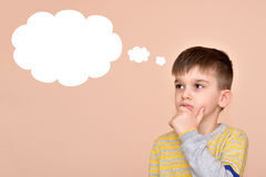 Thoughtful young boy. With an empty thought bubble Stock Image