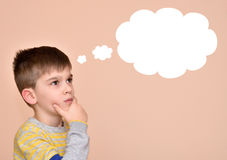 Thoughtful young boy. With an empty thought bubble Stock Photography